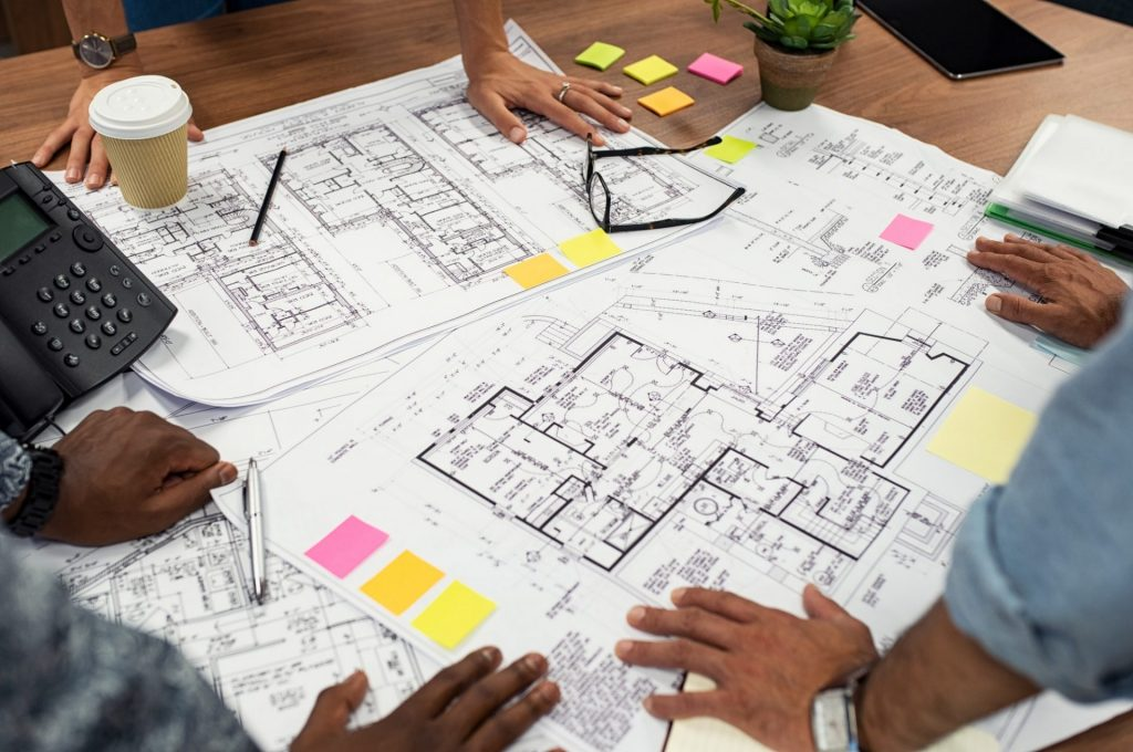 Architects working on blueprints